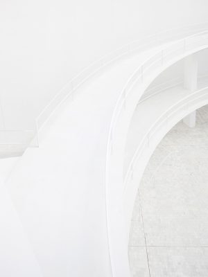 Double elevated curve walkway with steel banister, white minimal modern architecture detail